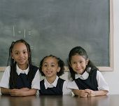stock photo of chums  - School girls smiling for the camera - JPG