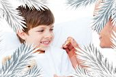 stock photo of pain-tree  - Handsome doctor taking little boys temperature against fir tree branches forming frame - JPG