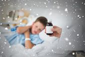 image of cough syrup  - Doctor holding cough syrup with boy in hospital against snow falling - JPG