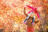 picture of fall day  - Happy mother and kid having fun together outdoor in autumn or fall park - JPG