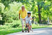 stock photo of grandfather  - happy grandfather and child have fun and play in park - JPG