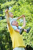 foto of grandparent child  - happy grandfather and child have fun and play in park - JPG