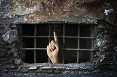 picture of dungeon  - Conceptual image of a hand reaching out from a dungeon - JPG