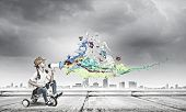 stock photo of tricycle  - Little cute girl of preschool age riding tricycle - JPG