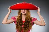 foto of sombrero  - Mexican woman wearing red sombrero - JPG