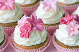 stock photo of sugarpaste  - Wedding cupcakes decorated in different shades of pink - JPG