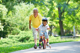 pic of grandparent child  - happy grandfather and child have fun and play in park - JPG