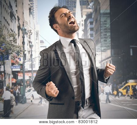 Businessman reaching a goal