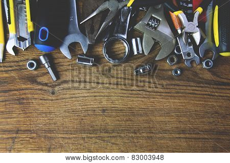 set of tools on wood board background