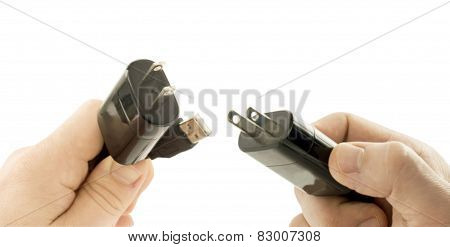 Plugs In The Two Hand For Electric Power