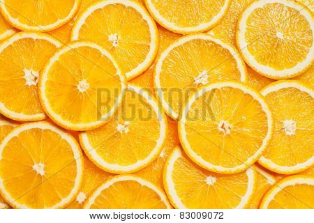 Colorful orange citrus fruit slices background top view