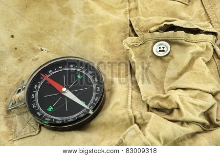 Compass On The Camouflage Bag