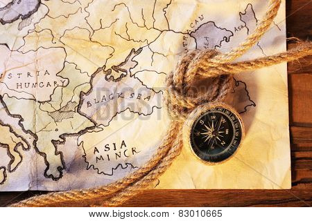 Marine still life with world map and rope on wooden table background
