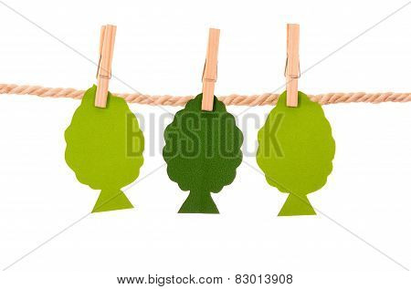paper trees hanging on a rope clothesline