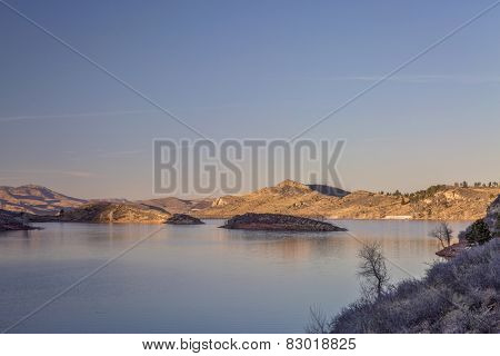calm winter sunset over Horsetooth Reservoir near Fort Collins in northern Colorado
