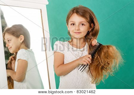 Girl with long curly hair and hairbrush