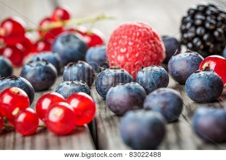 Fresh Berries and raspberry - Blueberries background closeup