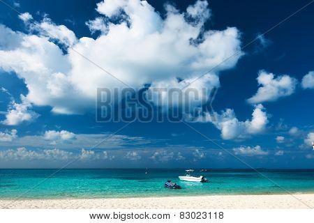 Beautiful island beach with motor boat at Maldives
