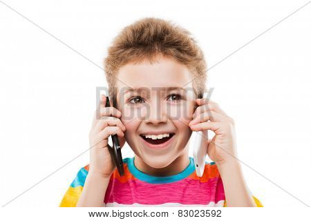 Beauty smiling child boy hand holding two mobile phones or talking pair of smartphones white isolated