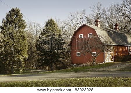 Old Red Barn In Field With Trees