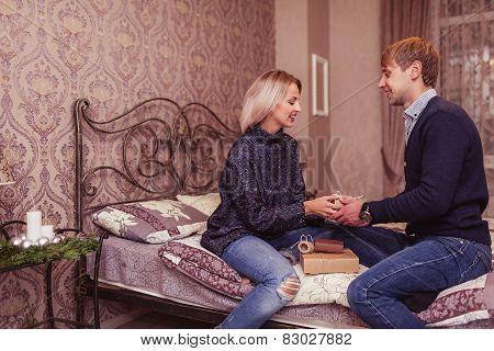 Couple in love in bedroom