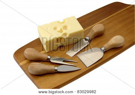 Cheese with holes on the cutting board