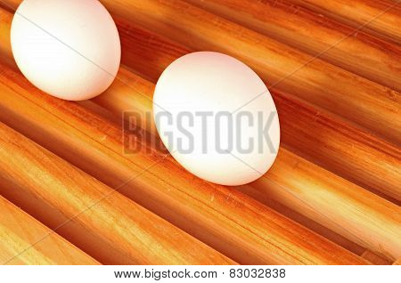 Fresh Eggs On A Wood, On White Background