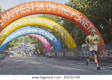 Young Color Runner Nears The Finish Line