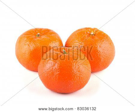 Three Clementines on white
