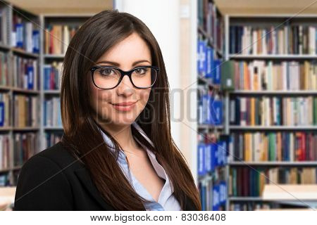 Portrait of a smiling woman in a library