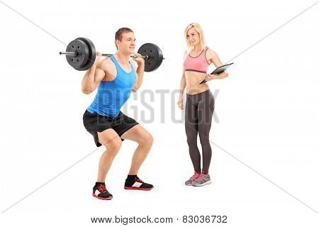 Man lifting a weight and a female coach standing next to him isolated on white background