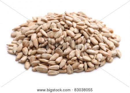 Peeled sunflower seeds isolated on white