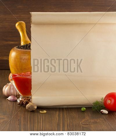 food spice and old paper on wooden background