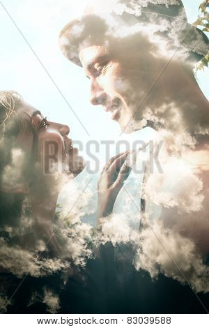 Double exposure portrait of a couple combined with photograph of clouds