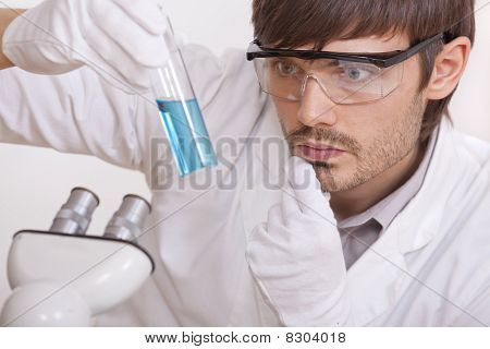 Researcher With Blue Liquid Tube