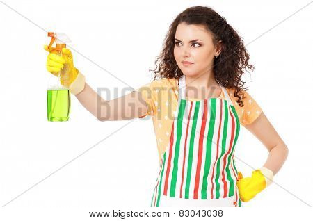 Young housewife with spray bottle, isolated on white background