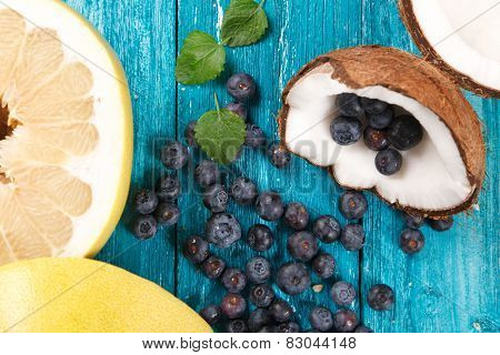 Blueberry, coconut and pomelo on wooden table