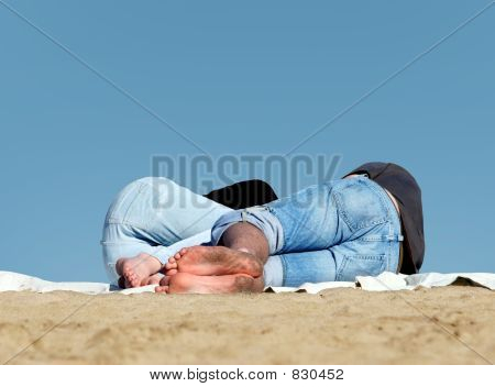 Couple sleeping on the beach
