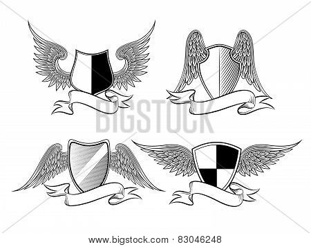 Heraldic shields with wings