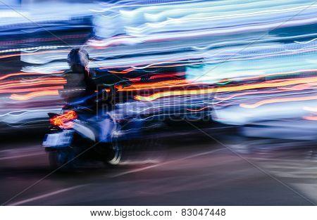 Scooter In A Blurred City Scene