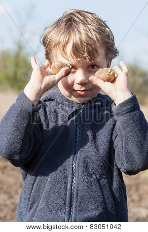 Portrait Of Boy With Potatoes