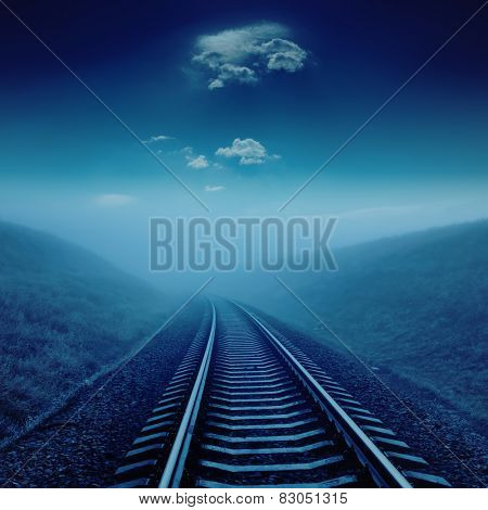railroad in night under blue moonlight