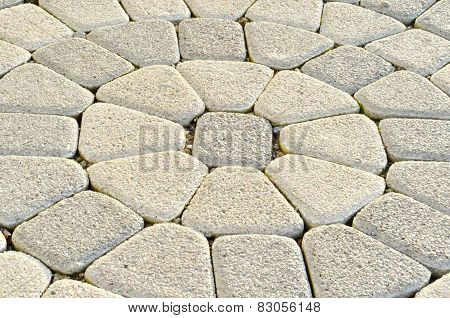 Stone pavement in perspective. Circle paving.