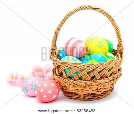 Colorful Handmade Easter Eggs In The Basket And Flowers Isolated