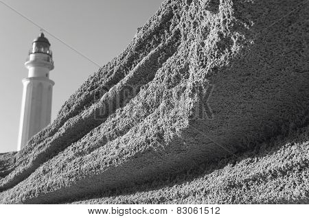 Sand Rock And Trafalgar Lighthouse In Spanish Coastline. Cadiz