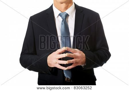 Close up on businessman's clenched hands.