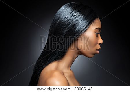 Profile Of An Young Black Beauty With Long Straight Hair