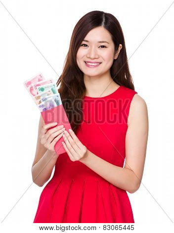 Asian woman hold red pocket with RMB