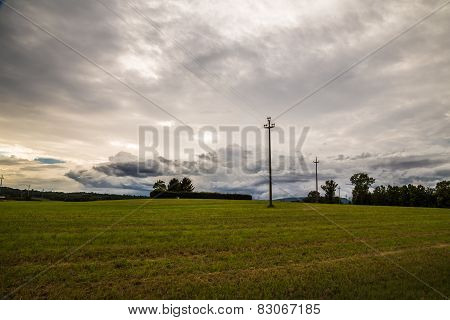 Energy Cable In The Fields Of Italy