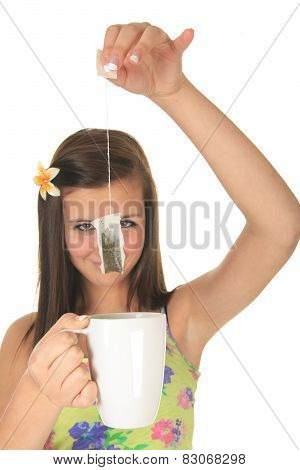 Studio image of a beautiful little lady with tea